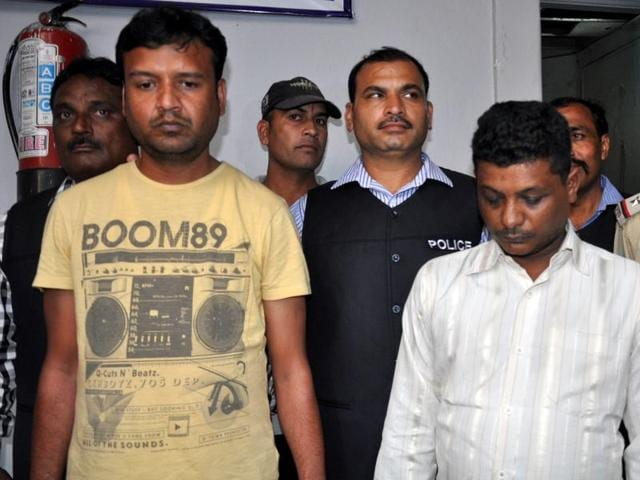 Accused Rinku Veram (left) and Yogendra in police custody in Indore on Monday.