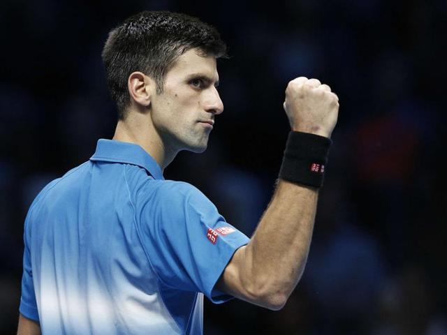 Novak Djokovic holds the year-end World No. 1 trophy after his win over Kei Nishikori.