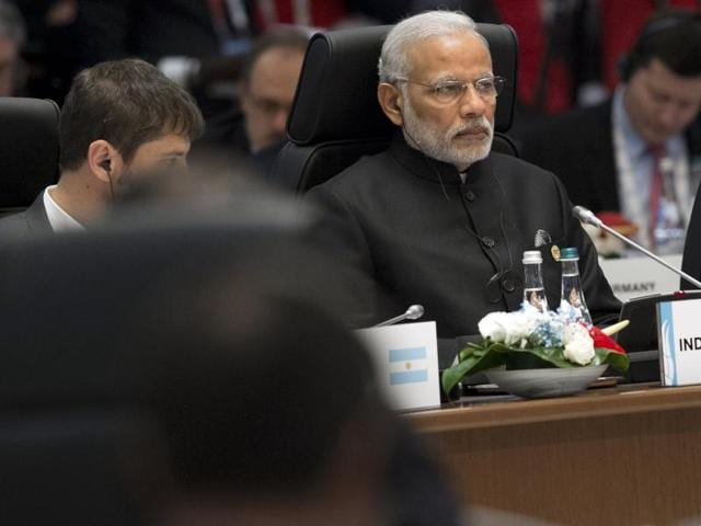 Indian Prime Minister Narendra Modi (R) attends a working session on the Global Economy during the G20 summit in Antalya.