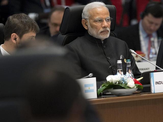 Prime Minister Narendra Modi (R) attends a working session on the Global Economy during the G20 summit in Antalya.