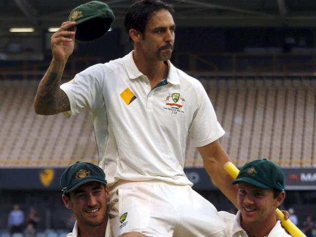 Australia's Mitchell Johnson reacts as he is clapped off the field by his team mates during the fifth day of the second Test against New Zealand in Perth on November 17, 2015.