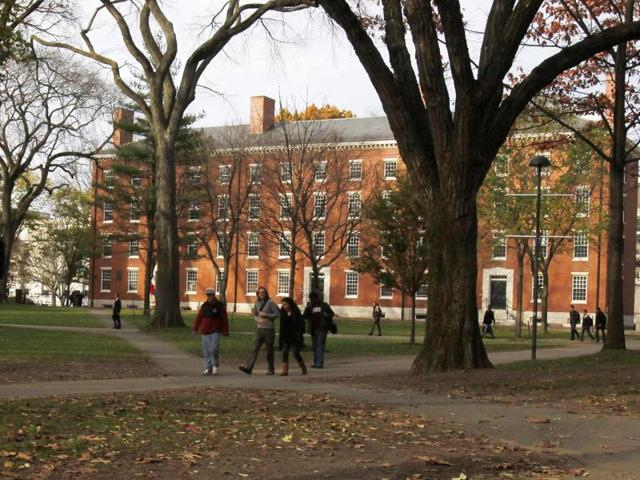 A student walks through Harvard Yard at Harvard University in Cambridge, Massachusetts, in this file photo taken November 16, 2012. Harvard University said on its website on Monday that it had received an