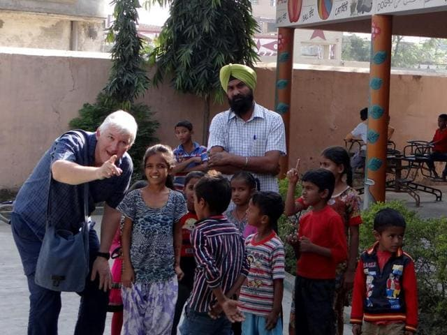 David Gee interacting with children of Government Middle School at Singhpur Dona village in Jalandhar on Monday.