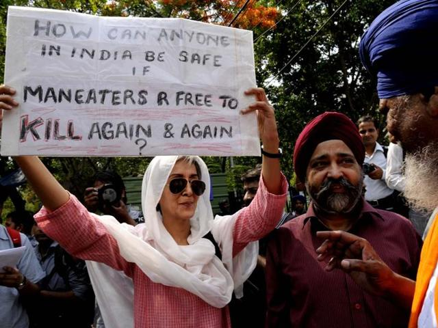 Victims of the anti-Sikh riots hold a demonstration against the accused in Delhi.