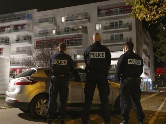 French police secure the area outside a housing complex as police conduct a door-to-door search operation in the Neudorf neighbourhood in Strasbourg, France.