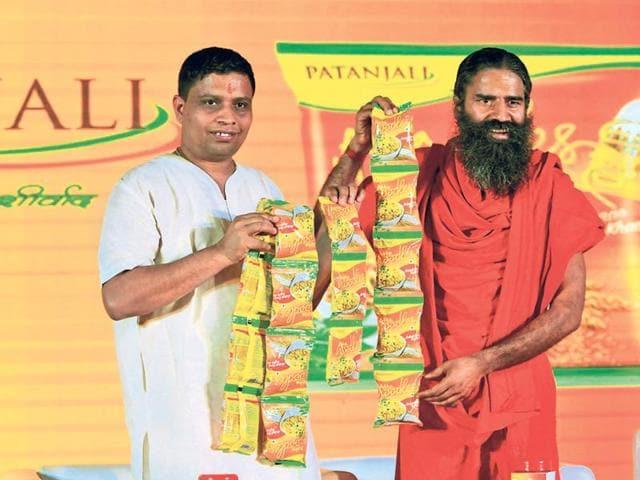 Acharya Balkrishna (L) and Baba Ramdev launching Patanjali's Atta Noodles in New Delhi