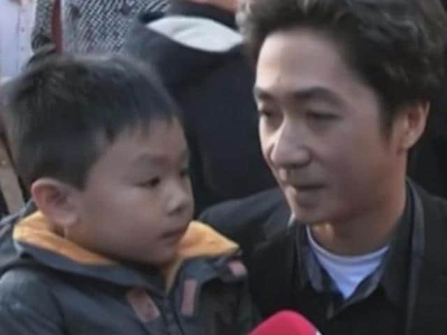 A screen grab of the video of the conversation between the father and his son in Paris.
