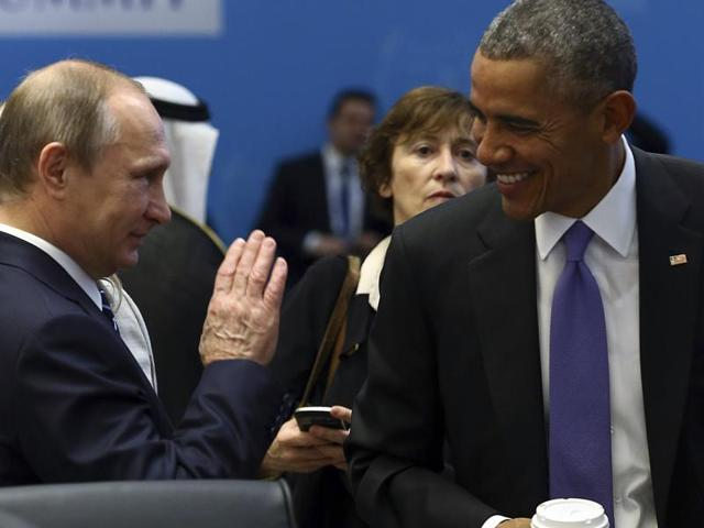 US President Barack Obama,  talks with Russian President Vladimir Putin prior to a session of the G-20 Summit in Antalya, Turkey.