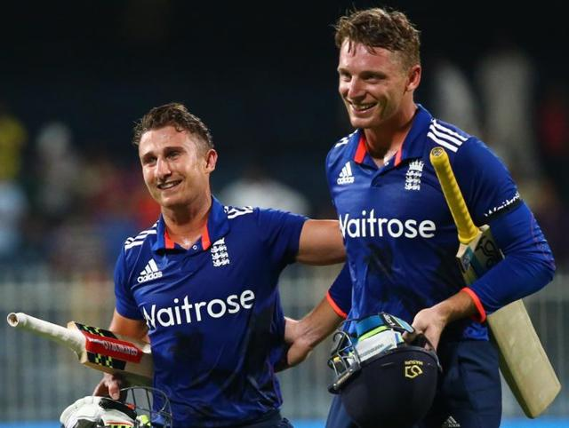 England's James Taylor (L) and Jos Buttler (R) leave the pitch at the end of the third ODI against Pakistan at the Sharjah Cricket Stadium in Sharjah on November 17, 2015.