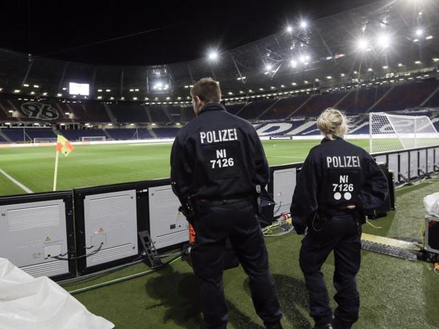 Two police officers stand in the stadium in Hanover, Germany after a friendly football match between Germany and the Netherlands was cancelled 90 minutes before kick-off on Tuesday due to the suspected threat of a bomb at the stadium.