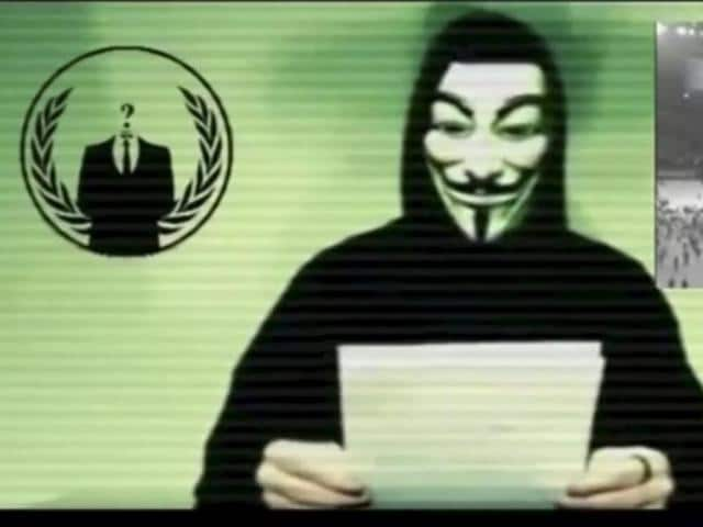 A man wearing a mask associated with Anonymous makes a statement in this still image from a video released on November 16, 2015.