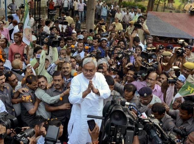 Bihar chief minister Nitish Kumar is surrounded by journalists as he greets supporters after victory in the state assembly elections.