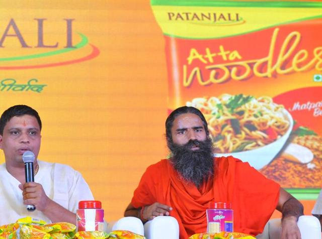 Baba Ramdev and Patanjali Yogpeeth, Balkrishna launching Patanjali Atta Noodles, in New Delhi on Monday, 16 November 2015.  Patanjali has denied a report in a newspaper that it did not have mandatory product approval from FSSAI.