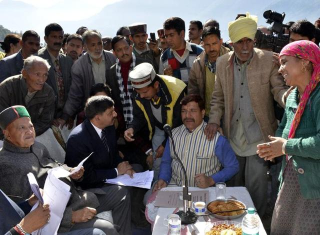 Himachal chief minister Virbhadra Singh meeting villagers at Kotla village in Himachal.  As many as 72 houses were gutted in the Sunday night blaze.