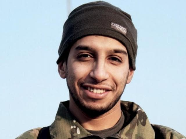 This undated image made available in the Islamic State's English-language magazine Dabiq, shows Belgian Abdelhamid Abaaoud.  Abaaoud's fate was unknown on Wednesday after a massive police raid in a suburb of the city that left at least two dead, including a female suicide bomber.