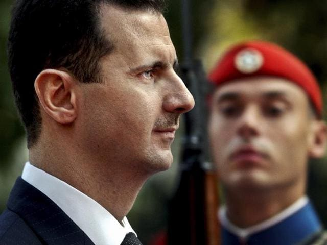 In this file photo, Syrian President Bashar Assad reviews the presidential guard during a welcoming ceremony in Athens.