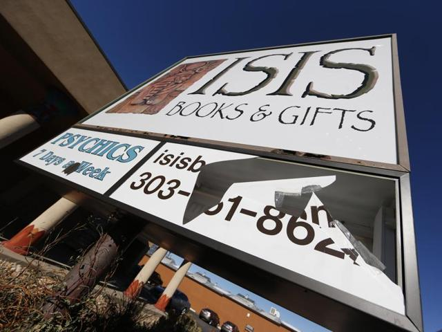 A panel of the sign outside Isis Books and Gifts store is broken Wednesday, Nov. 18, 2015, in Englewood, Colo.
