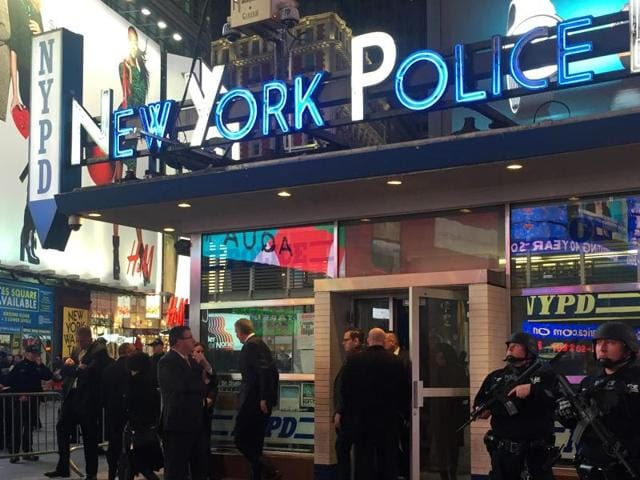 Police officers stand guard in Times Square, New York. The New York Police Department said it is aware of recently-released video by the Islamic State but there is no current or specific threat to the city.