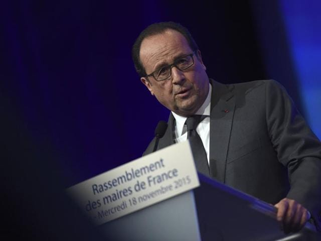 President Francois Hollande delivers a speech during a meeting of French mayors in Paris.