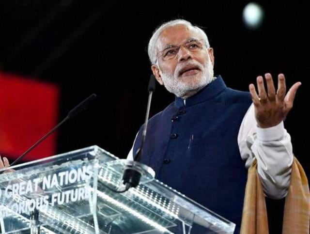 Prime Minister Narendra Modi addressing Indian community at Wembley Stadium in London on Nov 13, 2015.
