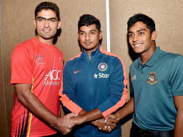 U-19 Afghanistan Captain Ihsanullah Janat, India captain Ricky Bhui and Bangladesh Captain Mehidy Hasan Miraz join hands together during a photo session on the eve of the start of U-19 Cricket Tri-series one day cricket tournament in Kolkata.