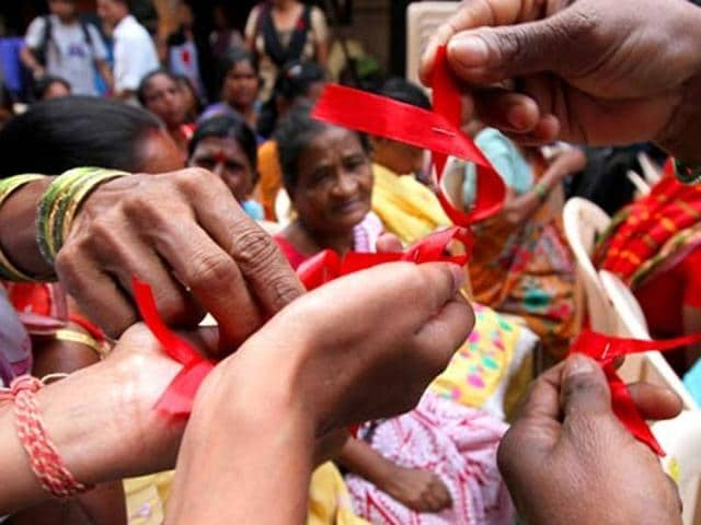 Sex workers distribute red ribbons, symbol of the fight against AIDS, in a rally on World Aids Day in Mumbai. For the first time, a group will demand legal rights.(Vijayanad Gupta/ HT photo)