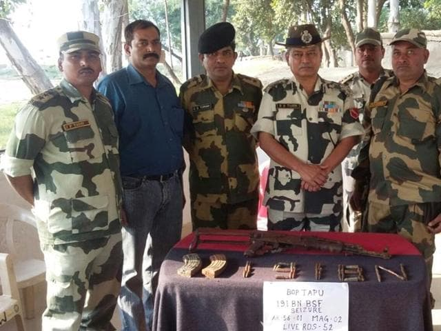 Border Security Force personnel along with seized ammunition.