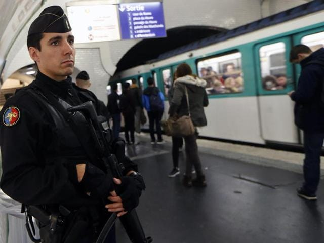 A French gendarme enforcing the Vigipirate plan, France's national security alert system, patrols in a railway station in Paris.