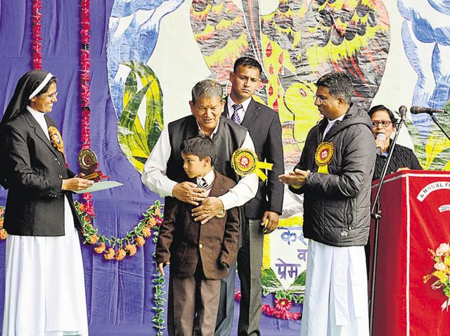Chief minister Harish Rawat awards a meritorious student at the annual day function of St Thomas School on Thursday.
