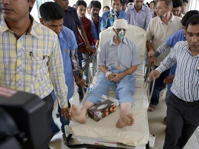 Piero Parolari sits wounded in a hospital after being shot in Dinajpur, some 350 kilometres (220 miles) north of Dhaka.