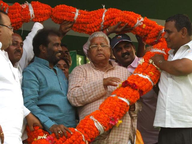 Former minister Shyam Razak with RJD chief Lalu Prasad during an election rally.
