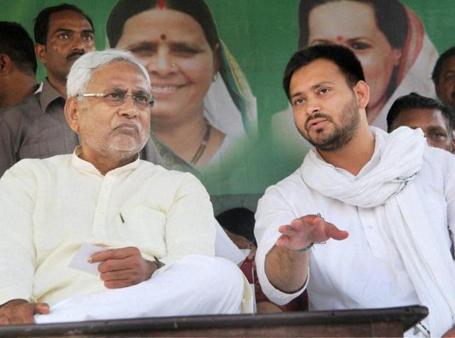 Bihar CM Nitish Kumar with RJD candidate and son of Lalu Prasad Yadav, Tejashwi Prasad Yadav during election campaign rally in Bidupur.
