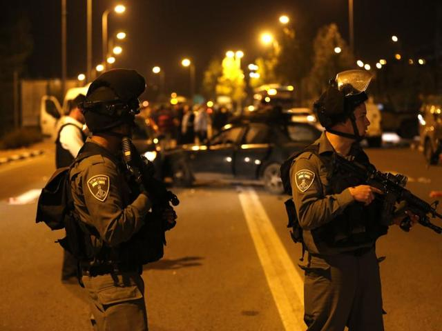 At least one attacker opened fire from a car then crashed into a group of pedestrians near a Jewish settlement in the West Bank, police and the army said.