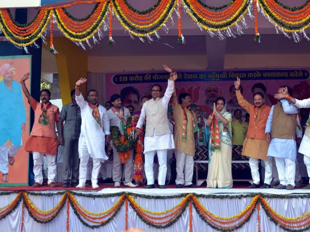 Chief minister Shivraj Singh Chouhan waves at the crowd during a public meeting in Dewas on Thursday.