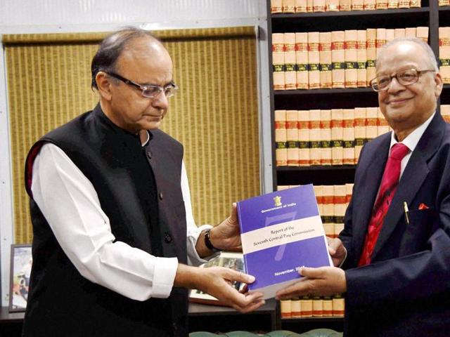 Finance Minister Arun Jaitley receives the report of Seventh Pay Commission from its chairman Justice A K Mathur in New Delhi.
