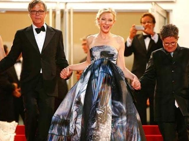 (L-to-R) Rooney Mara, Todd Haynes, Cate Blanchett and US screenwriter Phyllis Nagy leave the Festival palace after the screening of the film Carol Cate is seen in a Giles Deacon dress.