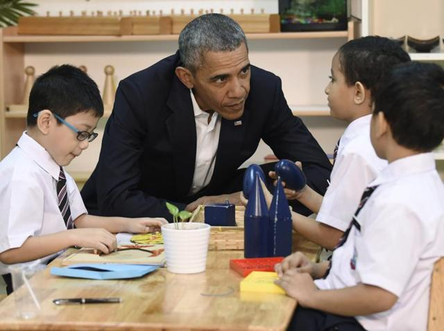 President Barack Obama meets with children as he tours the Dignity for Children Foundation in Kuala Lumpur, Malaysia.