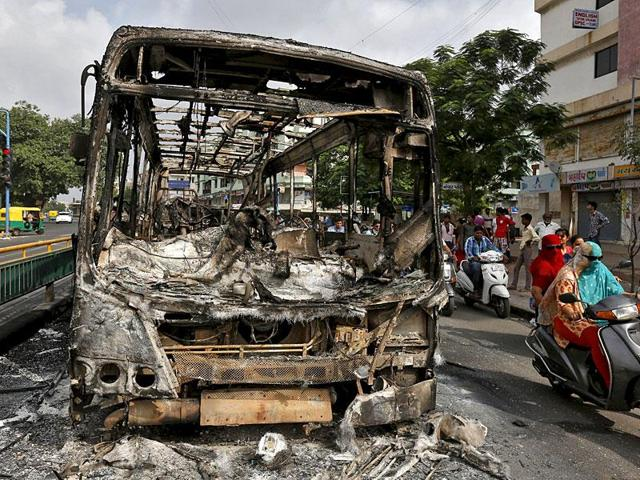 The wreckage of a bus burnt during the clashes between the police and quota agitators in Ahmedabad in August.