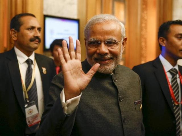 India's Prime Minister Narendra Modi leaves after attending the ASEAN Business and Investment Summit in Kuala Lumpur, Malaysia.