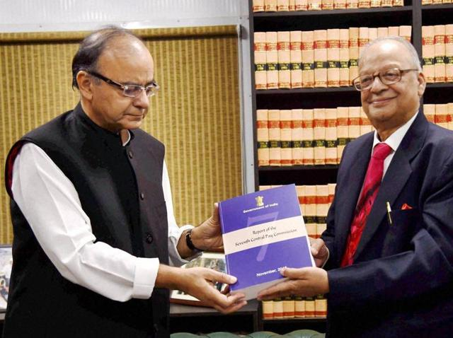 Finance Minister Arun Jaitley receiving the report of Seventh Pay Commission from its Chairman Justice A K Mathur in New Delhi on Thursday.