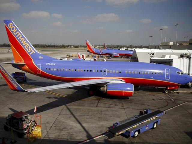 Two men were temporarily kept off a Southwest Airlines flight because a fellow passenger had overheard them speaking Arabic.