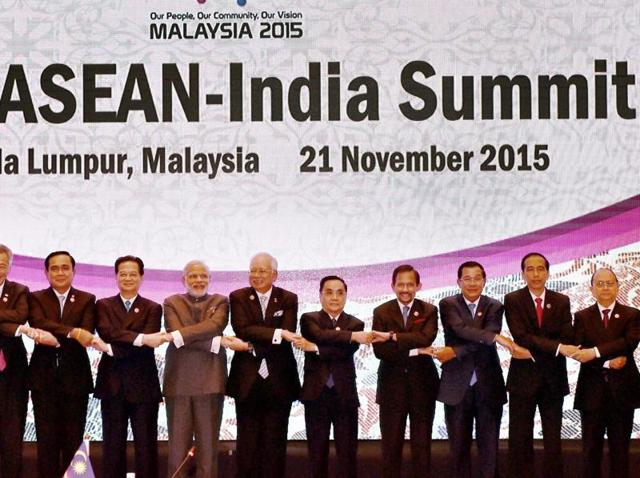 Prime Minister Narendra Modi join hands with other leaders during the 13th ASEAN-India Summit in Kuala Lumpur.