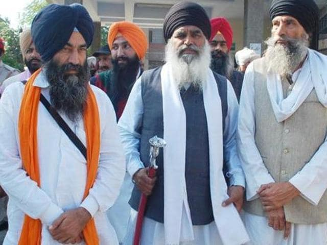 Sikh leader Dhian Singh Mand(in middle)  is one the leaders arrested by the Punjab Police.
