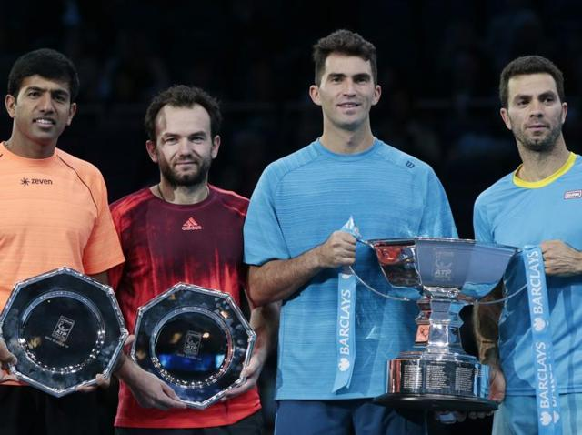Jean-Julien Rojer, right, and Horia Tecau lift the winner's trophy after beating Rohan Bopanna and Florin Mergea in the ATP World Tour Finals doubles final at the O2 Arena in London on November 22, 2015.