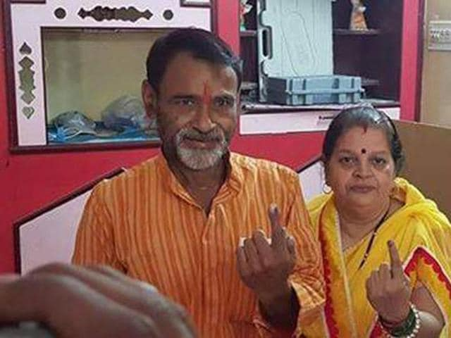 Congress candidate Jai Prakash Shastri with his wife after casting his vote in Dewas.