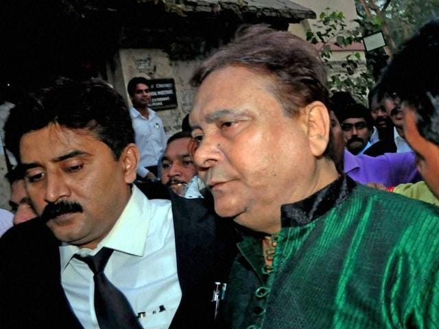TMC leader and former West Bengal minister Madan Mitra arrives at a local court to surrender himself in Kolkata after Calcutta high court rejected his bail petition.