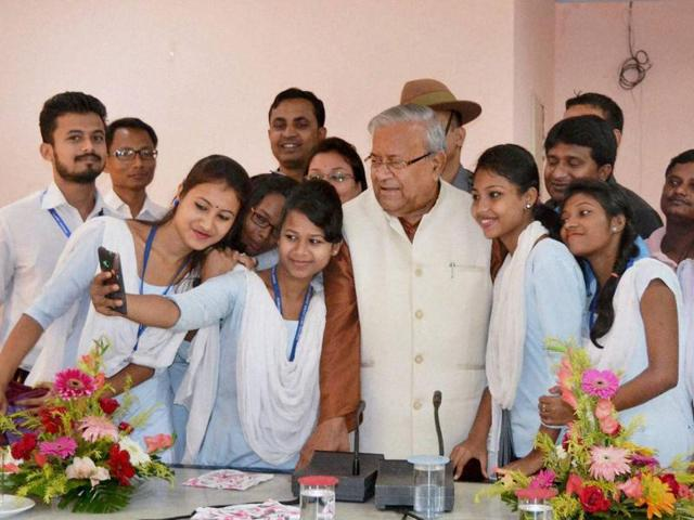 Students take selfie with Assam Governor PB Acharya at Circuit House, in Nagaon District of Assam.