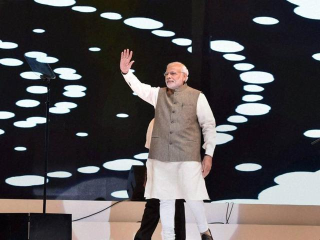 Prime Minister Narendra Modi addresses people from Indian community during an event in Kuala Lumpur, Malaysia on Sunday .