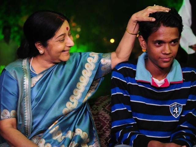 Minister of external affairs Sushma Swaraj meeting with Pakistani Boy Ramzan, in Bhopal, India, on Sunday, November 22, 2015. Sushma Swaraj assured him all help to reunite him with his mother in Pakistan.