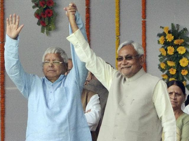Nitish Kumar signing the register after taking oath as chief minister of Bihar at Gandhi Maidan in Patna on Friday.